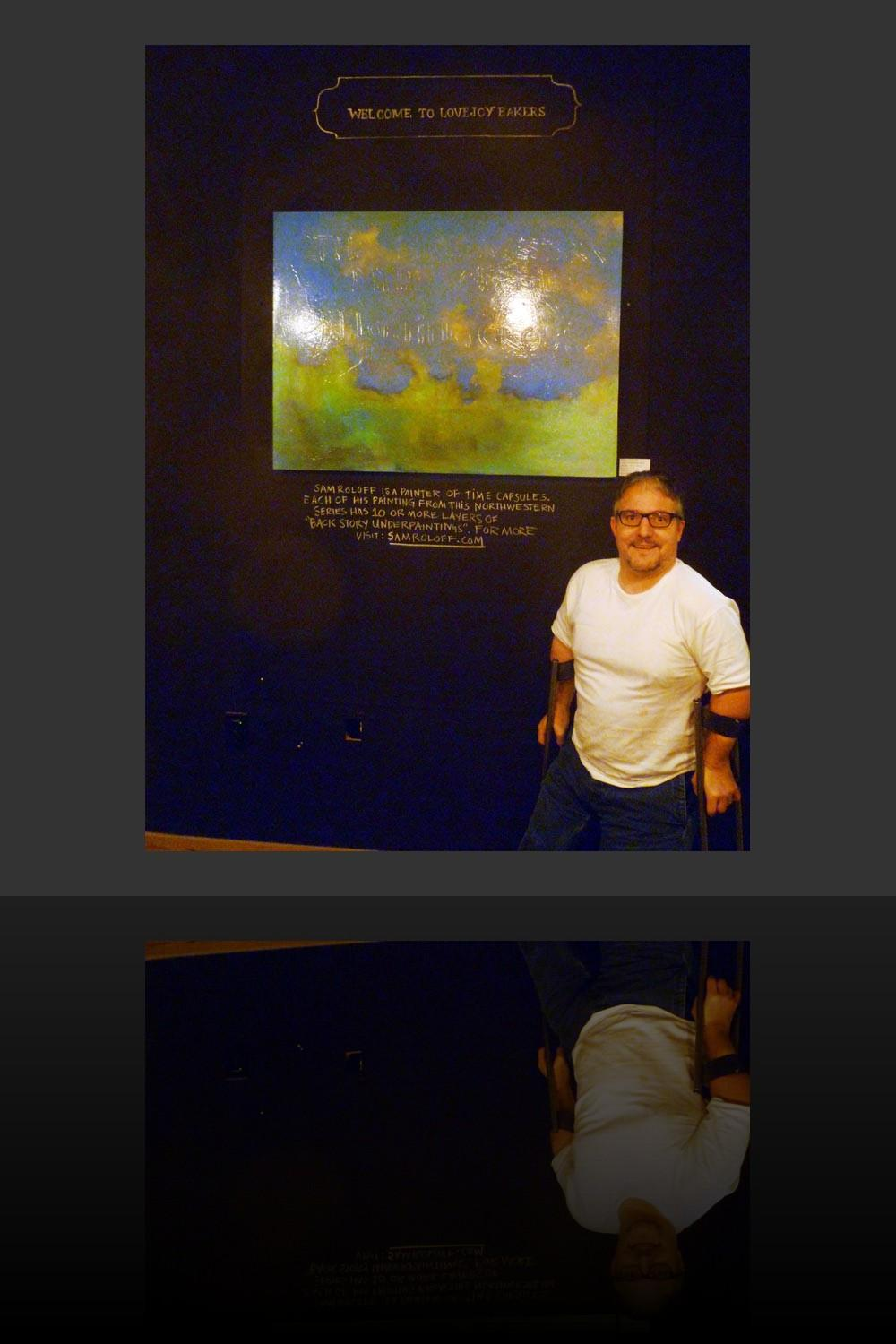 Sam Roloff standing in front of the painting