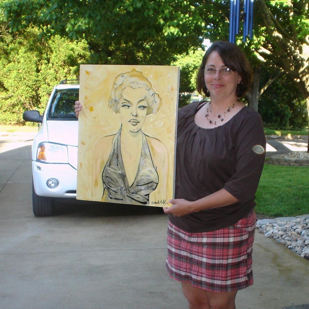 Tracy Blind Bangharts holds Marilyn Monroe