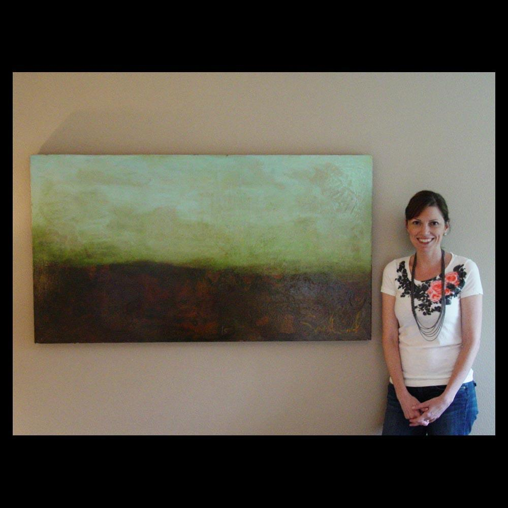 Dr. Britt Anderson stands in front of Twitterberry Painting by Sam Roloff