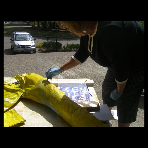 Peggy Roloff paints flowers on ac green pants