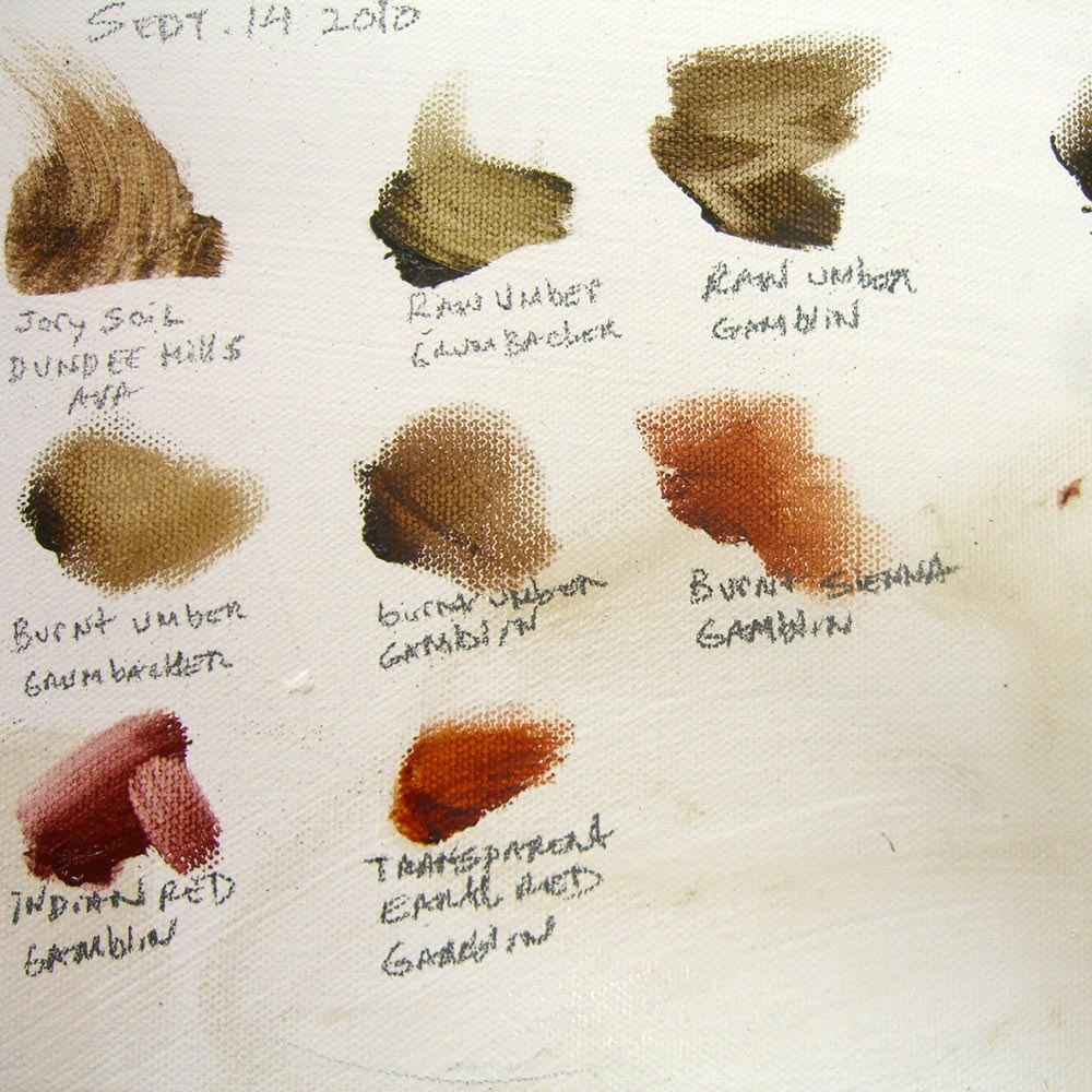 paint samples next to jory soil oil paint