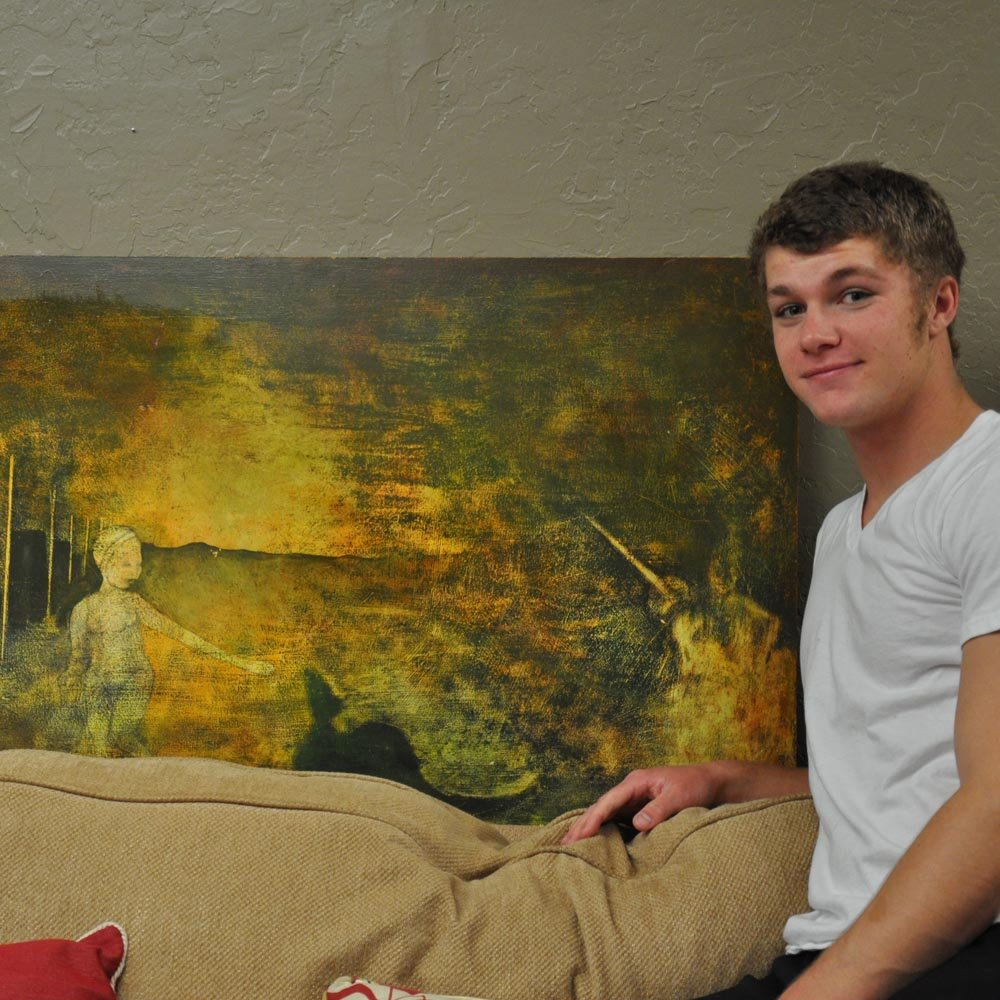 Jeremy Roloff stands next to painting by Sam Roloff