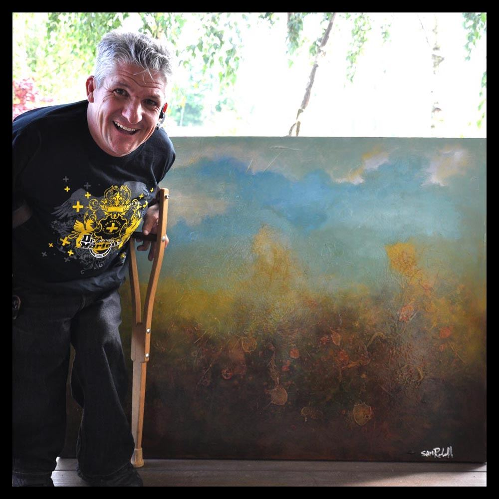 Matt Roloff  standing next to his painting by younger brother Sam Roloff