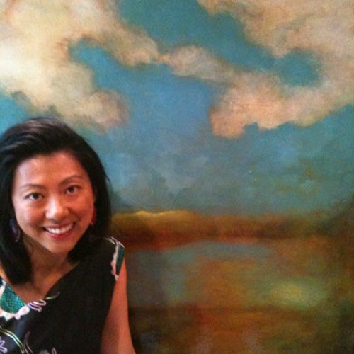 Nancy Hur-Crabbe in front of Sam Roloff\'s painting
