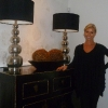 Cathrine Olander standing in next to her painting inside of her house in Portland Oregon USA