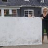 Cathrine Olander standing in next to her painting in front of her house in Portland Oregon USA