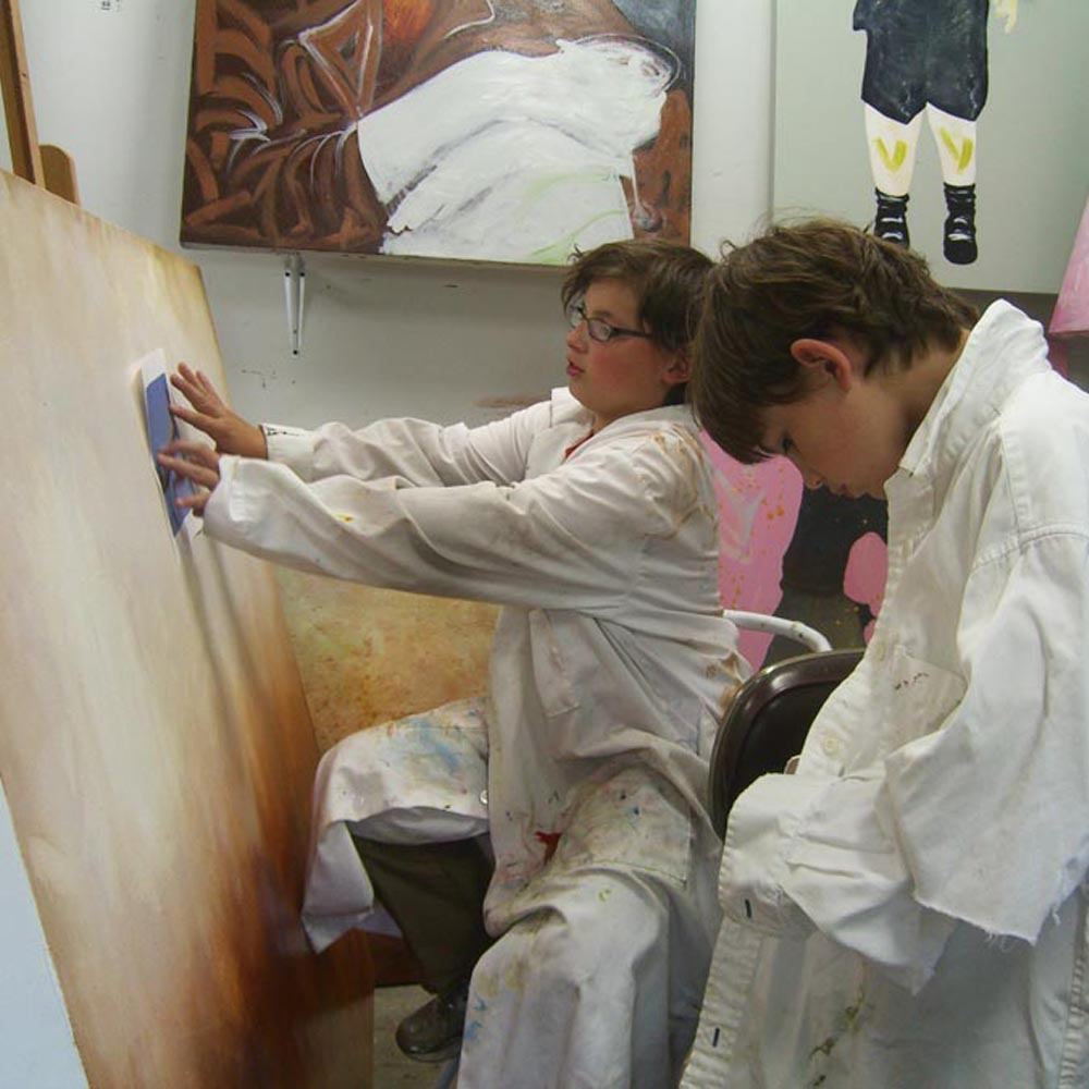 art class Max & Henry Roloff working on a painting