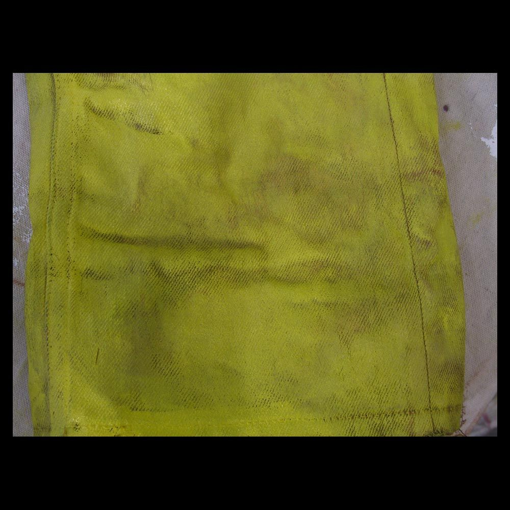 Yellow painted jeans, looks like leather