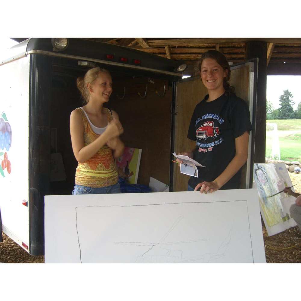 Molly Roloff and friend start painting with the helicopter