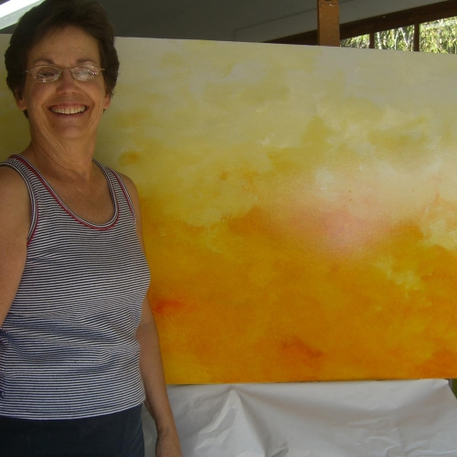 Pat Trice stands in Roloff's studio after buying the painting